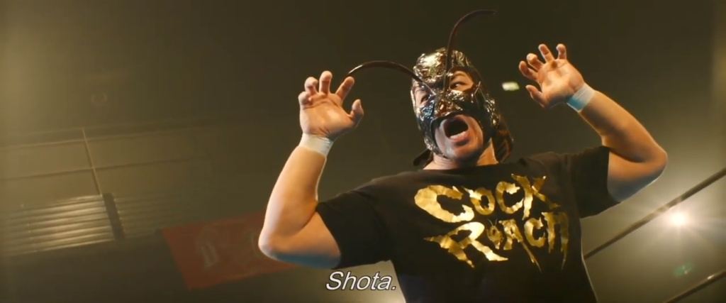 Cockroach Mask notices his son in the audience.